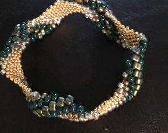 Wavy bangle beaded bracelet on wrinkled wrist
