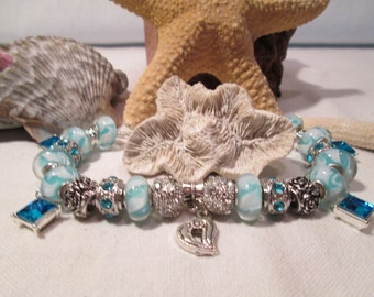 European style bracelet in teals,whites and silver