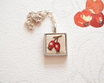 Hand embroidered silk Rosehip pendant