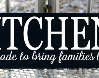 Kitchens were made to bring families together wood sign
