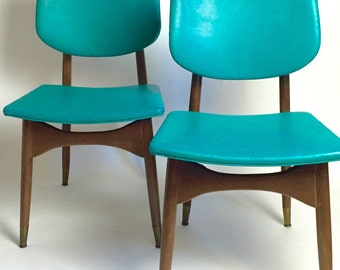 Chairs a pair. Molded plywood and vinyl  Danish modern chairs
