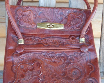 1950's hand tooled bag.