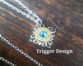 40 Caliber Bullet Necklace with Filigree Base Necklace - Light Blue