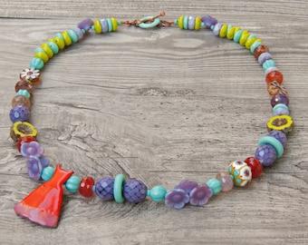 Whimsical asymmetrical boho necklace colorful Czech glass Pinocean  lampwork ArtIncendi enamel jewelry