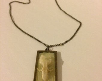 Mouse skull pendant