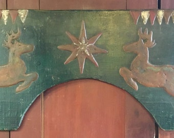 Two Leaping Deer and Star