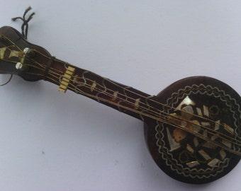 Antique tortoiseshell guitar instrument for repurpose assemblage