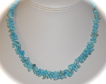 Natural Turquoise nuggets woven into a necklace measuring 17.5 inches with a sterling silver clasp and a 2 inch sterling extender chain.