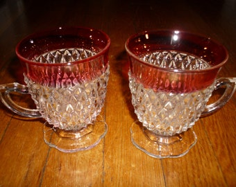 2 Cranberry Glass footed punch cups with handle