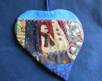 Christmas ornament heart shaped, snowmen center, crazy quilt sewing, white machine decorative stitching, width  5 inches, length 5 inches.