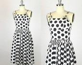 30% OFF, Anniversary Sale 1950s. black and white polka dot day dress. full skirt and adjustable straps. extra small