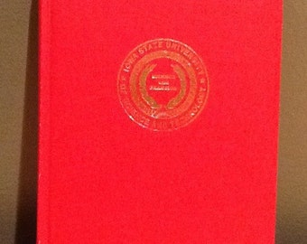 Vintage Iowa State University Science and Technology red blank book. Book is in used vintage condition with imperfections from age. Would be