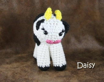 Daisy the Cow - small, black and white, stuffed animal toy