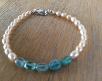 Freshwater peach pearl bracelet accented with aqua blue apatite