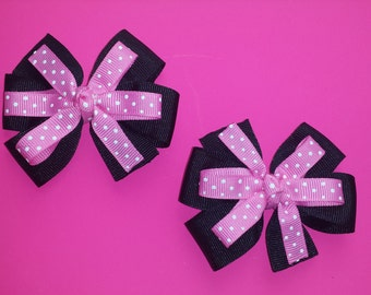 pink and black pig tail hairbows