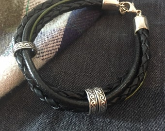 Men's thick multi strand bracelet with sterling silver tube/beads.
