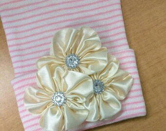 Newborn Hospital Hat with a cluster of 3 satin Ivory flowers; topped off with rhinestones. Cute!