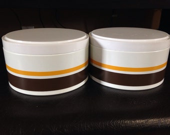 Pair of Ransburg Indianapolis low stacking canisters