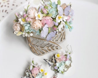Bracelet and earrings  with flowers and butterflies