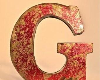 A fantastic vintage style metal 3D red letter G