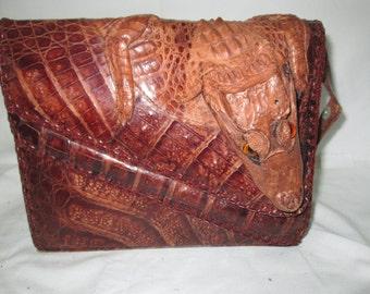 Fantastic Alligator Handbag with head, legs and back legs very good condition Great design adjustable strap