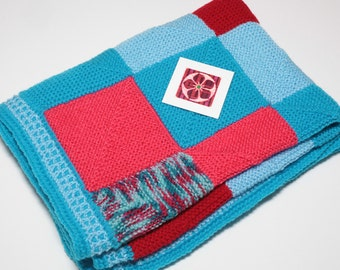 Hand Knit blanket, knit knee rug, cot cover, lap blanket, baby blanket, blue/pink/red, purchase price donated to charity, charity donation