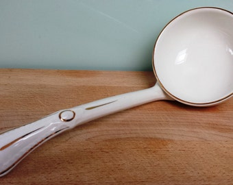Antique white porcelain ladle for soup tureen with gilding decoration