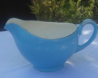Vintage Milk Jug Blue with gold finish along rim and handle