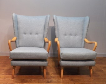 A Pair of Vintage Armchairs by Howard Keith. Re upholstered in pure new wool.