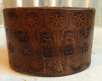 The tooled flower Wide Brown Leather Cuff
