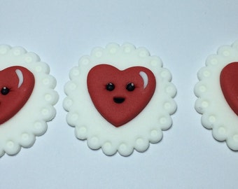 12 x Valentines hearts cupcake toppers made from gum paste fondant