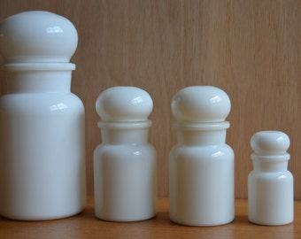 Set of four white apothecary jars in different sizes, milkglass, opaline, made in Belgium