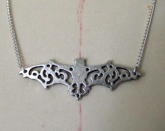 Bat silhouette necklace