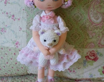 Soft cloth doll and her teddy bear
