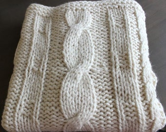 "Plaid, chunky knitted with cables in Alpakka wool and acrylic. Color ""naturel""."