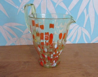 Vintage green art glass jug with orange & white spot/spatter detail