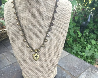 Crocheted Necklace with Shield Pendant