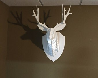 Upcycled fake taxadermy stag's head wall art.