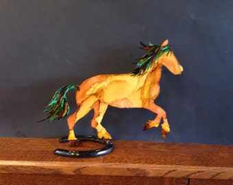 Hand Painted metal horse mounted on a horse shoe