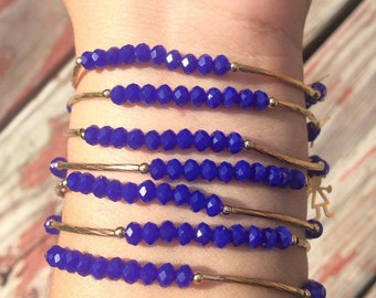 Solid Royal blue bracelets with gold plated charms - Semanario color azul rey solido con dijes de chapa de oro