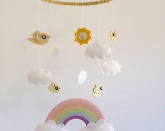 Pastel rainbow baby mobile with clouds, yellow and gold birds and golden sun