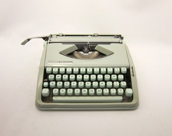 1968 - Hermes Baby Typewriter - Light sea foam green - Marine green - With Case - Cleaned and working