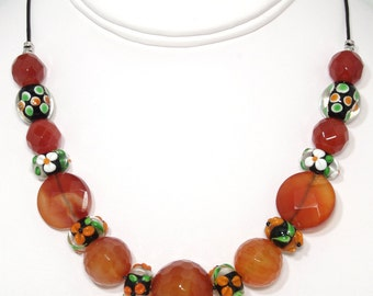 BN022- Necklace of large faceted Carnelian and colorful Lampwork Glass beads