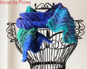 Handknitted scarf in vivid multicoloured green, blue and purple