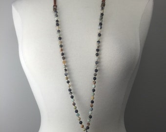 Handknotted beaded necklace with adjustable leather ties and  soldered horn pendant
