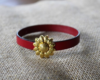 Red leather bracelet with gold flower magnetic clasp