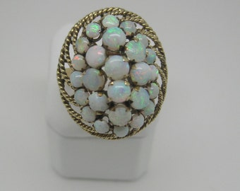 Vintage estate 18 carat opal cluster dome ring