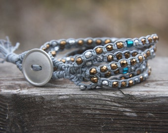 Gray-gold-silver multi-strand beaded bracelet, braided with waxed cord and glass beads