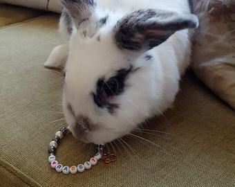 Swarovski creamrose glass pearl and acrylic gunmetal bracelet: I love rabbits!
