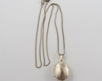 "Sterling Silver Oval Locket with a 16"" Light Curve Link Necklace"
